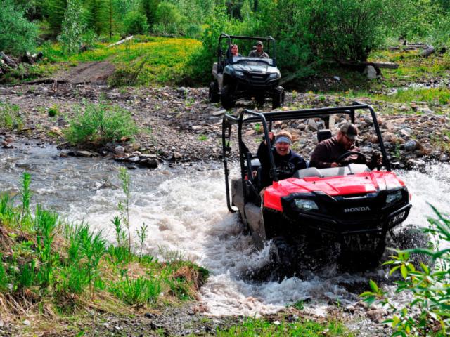 Crossing river in ATV 4x4